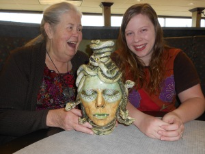 "Nan wanted to see ""the real Medusa"" which is on the cover of her new book. She met the artist for the first time and fell in love with the sculpture. She bought it on the spot, and it is now in Nan's livingroom. The artist is Sarah Love, 24. The photo was taken at their meeting at McDonald's in Nelsonville, Ohio."
